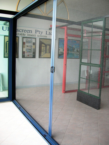 Retractable flyscreen doors into blinds for Vertical retractable screen