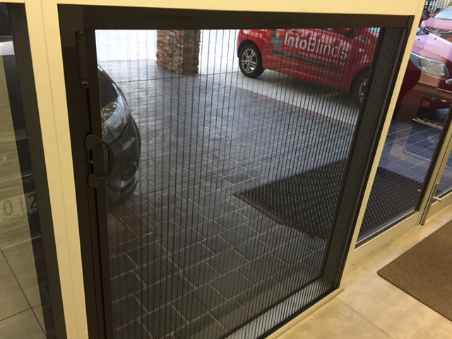 Retractable fly screens insect screens retractable into for Retractable window fly screens